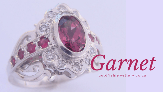Rhodolite Garnet with a total of 0,22ct Diamonds and eight little Rubies set in 9ct White Gold. Made by Goldfish Jewellery Design Studio.
